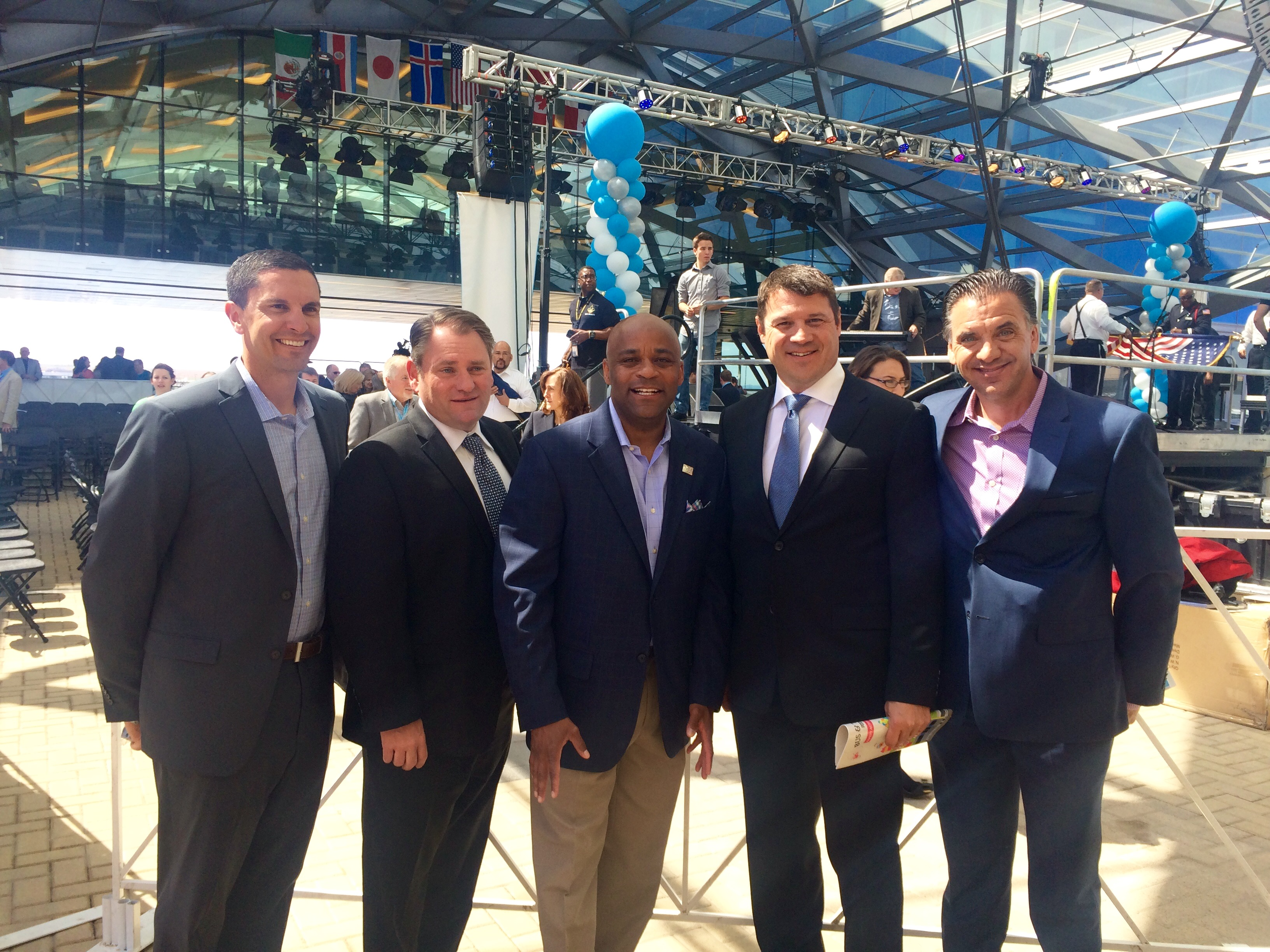 Representatives from RTL and Platte River Networks, Inc. at DIA for the opening ceremony with Denver Mayor Michael Hancock (center)